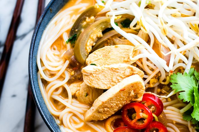This gluten free almond chicken pho is easy to make in a blender. It's dairy free, healthy, and delicious. Blended chili pepper almond sauce is mixed in with the broth to make this soup extra flavorful! A homemade pho recipe that warms the body and soul. | CotterCrunch.com