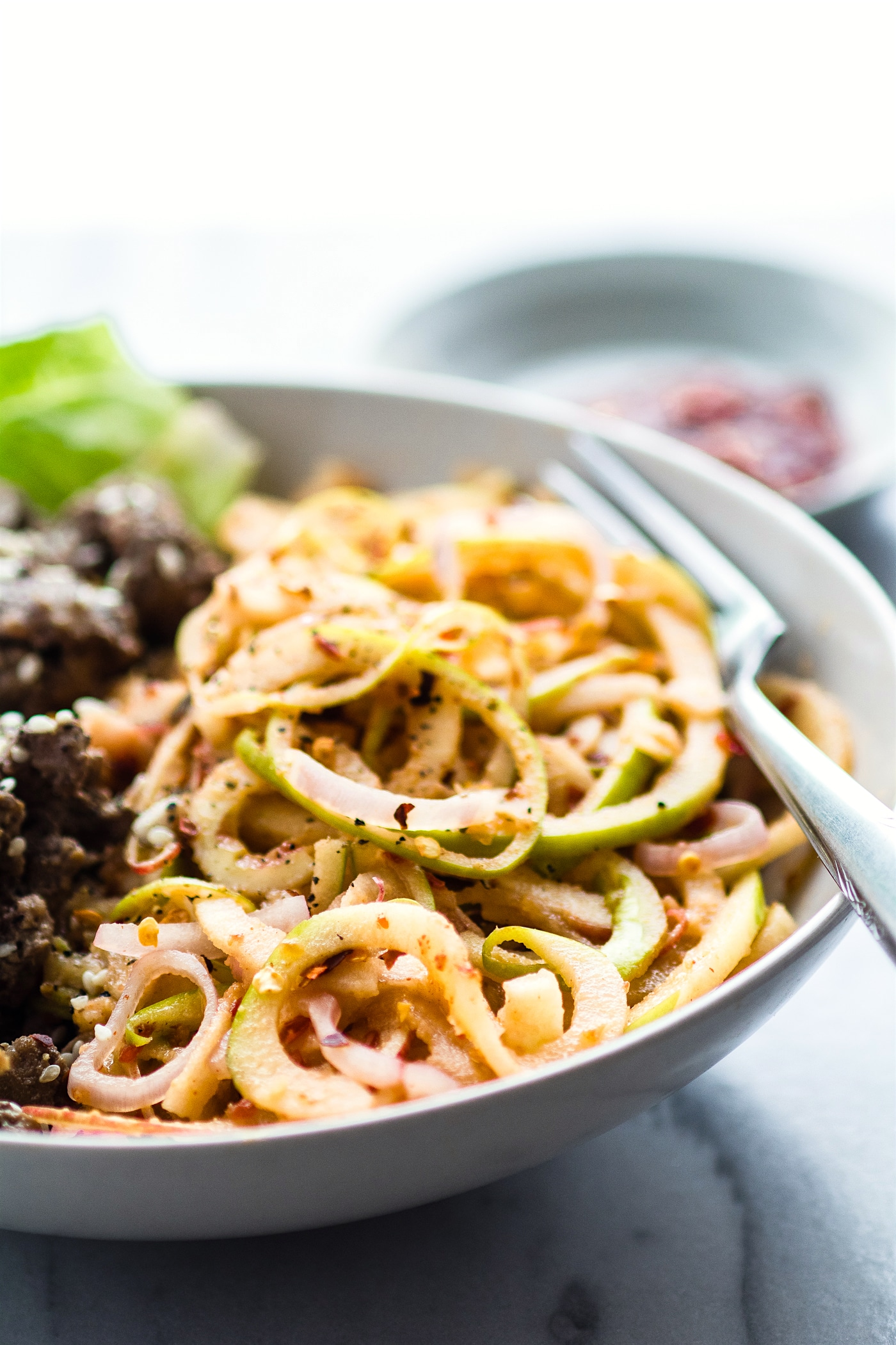 "Spiralized Apple ""kimchi"" salad with Garlic Beef! This Asian inspired salad makes a quick and healthy kimchi substitute. An easy Paleo power bowl meal ready in 20 minutes!"