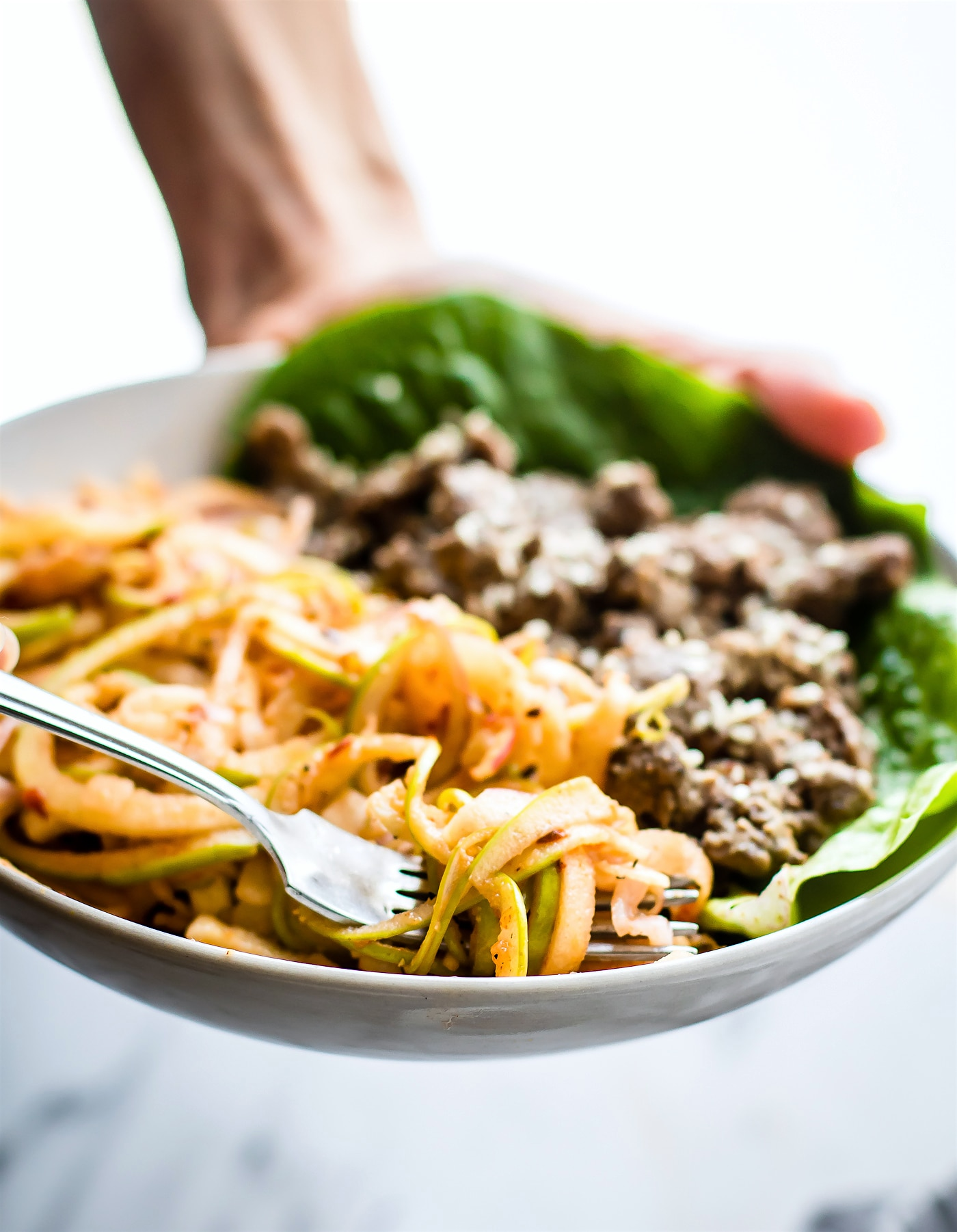 "Spiralized Apple ""kimchi"" salad with Garlic Beef! This healthy Asian inspired spiralized apple salad makes a quick kimchi substitute. A 20 minute Paleo meal! Part of dairy free and gluten-free anti-inflammatory meal plan"