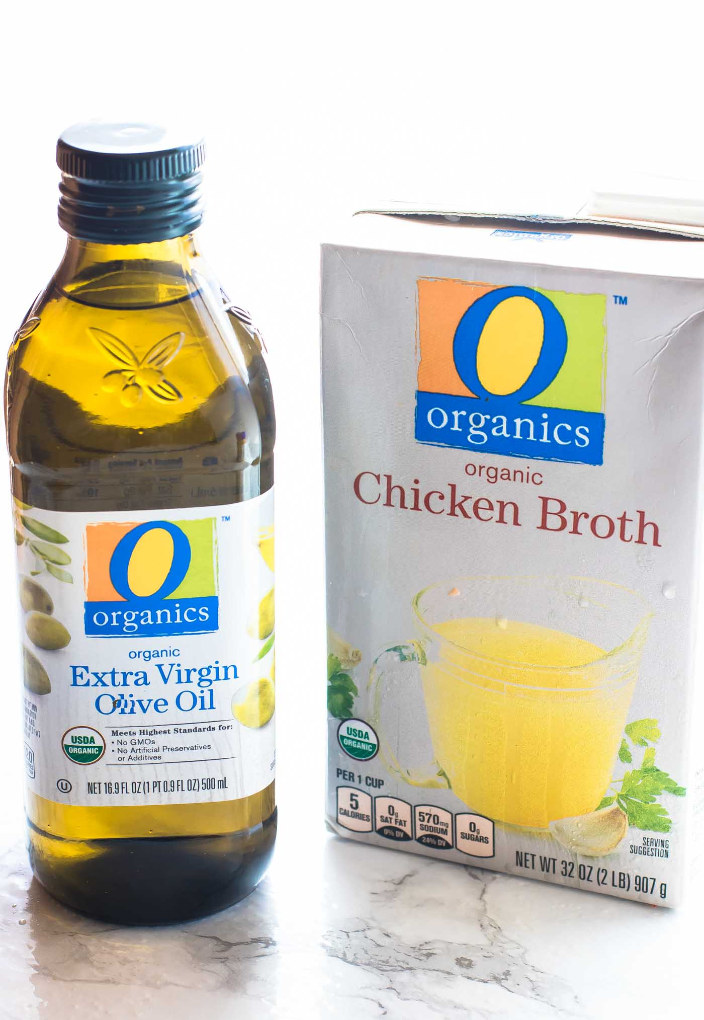 O Organics brand olive oil and chicken broth