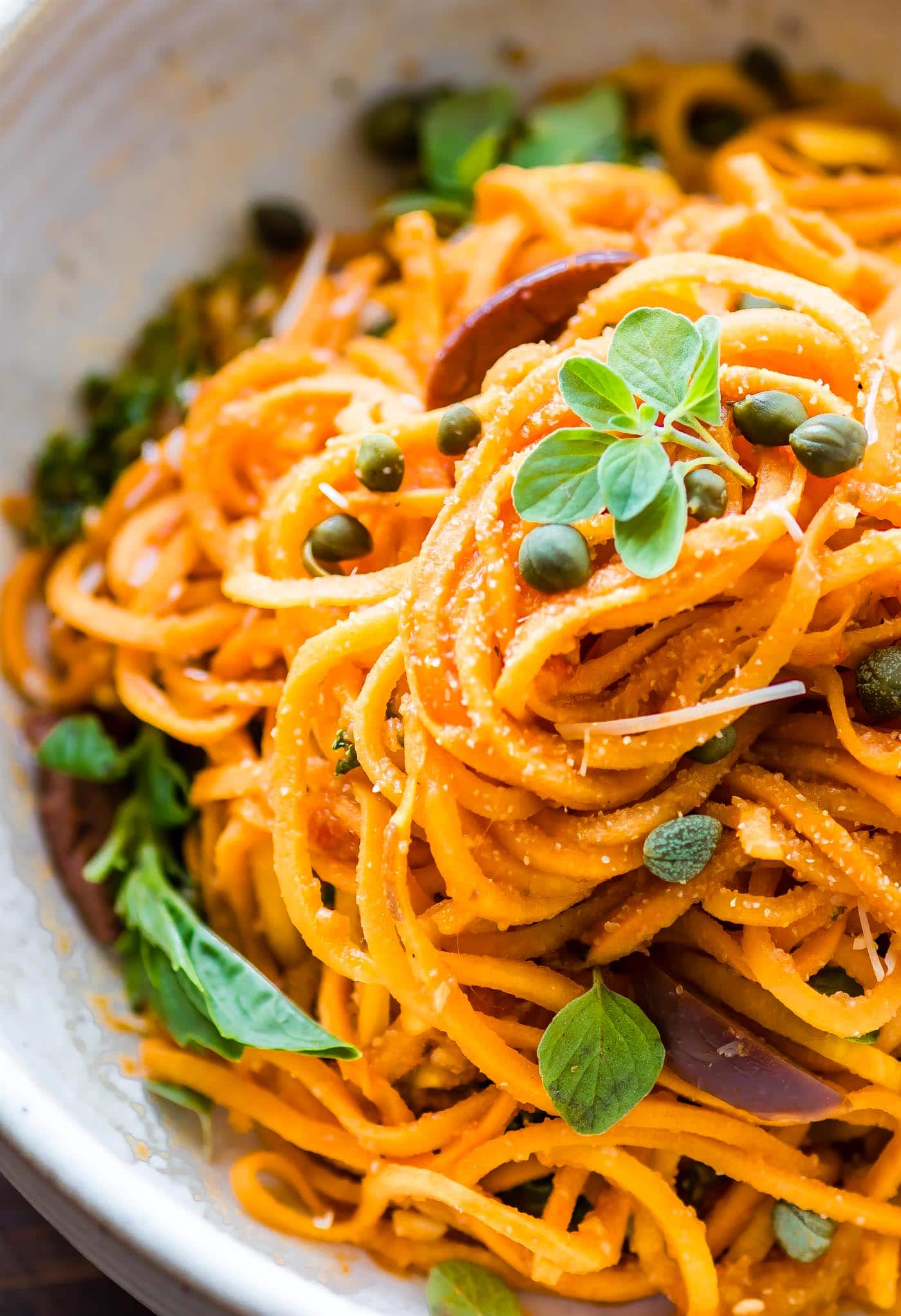 Sweet Potato Spaghetti made with spiralized sweet potatoes in zesty tomato sauce. Easy Italian Sweet Potato Spaghetti bowls that are quick, paleo, & vegan!