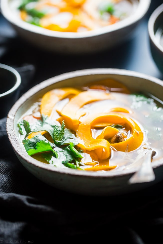 This crock pot chicken noodle soup has a Thai spin! It uses butternut squash noodles to keep it gluten free, paleo friendly and under 300 calories and 3 SmartPoints! A low-carb option is included!