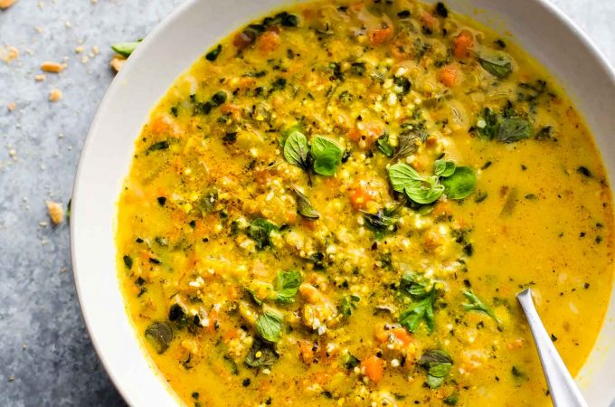 """Curried Cauliflower Rice Kale Soup is one flavorful healthy soup to keep you warm this season. An easy paleo soup recipe for a nutritious meal-in-a-bowl. Roasted curried cauliflower """"rice"""" with kale and even more veggies to fill your bowl! A delicious vegetarian soup to make again again! Vegan and Whole30 friendly! 