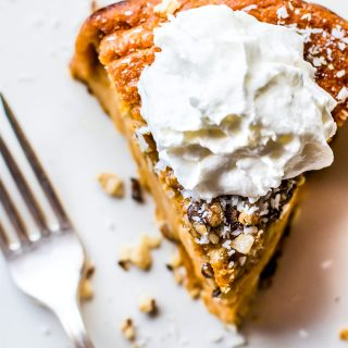 Impossibly EASY Paleo Sweet Potato Pie with coconut! A Paleo sweet potato pie recipe that's IMPOSSIBLE to mess up! Made with simple healthy ingredients! A paleo sweet potato pie that miraculously forms its own crust while baking. Ahh, yes, happy holidays indeed!