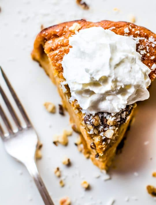 slice of paleo sweet potato pie with coconut whipped cream