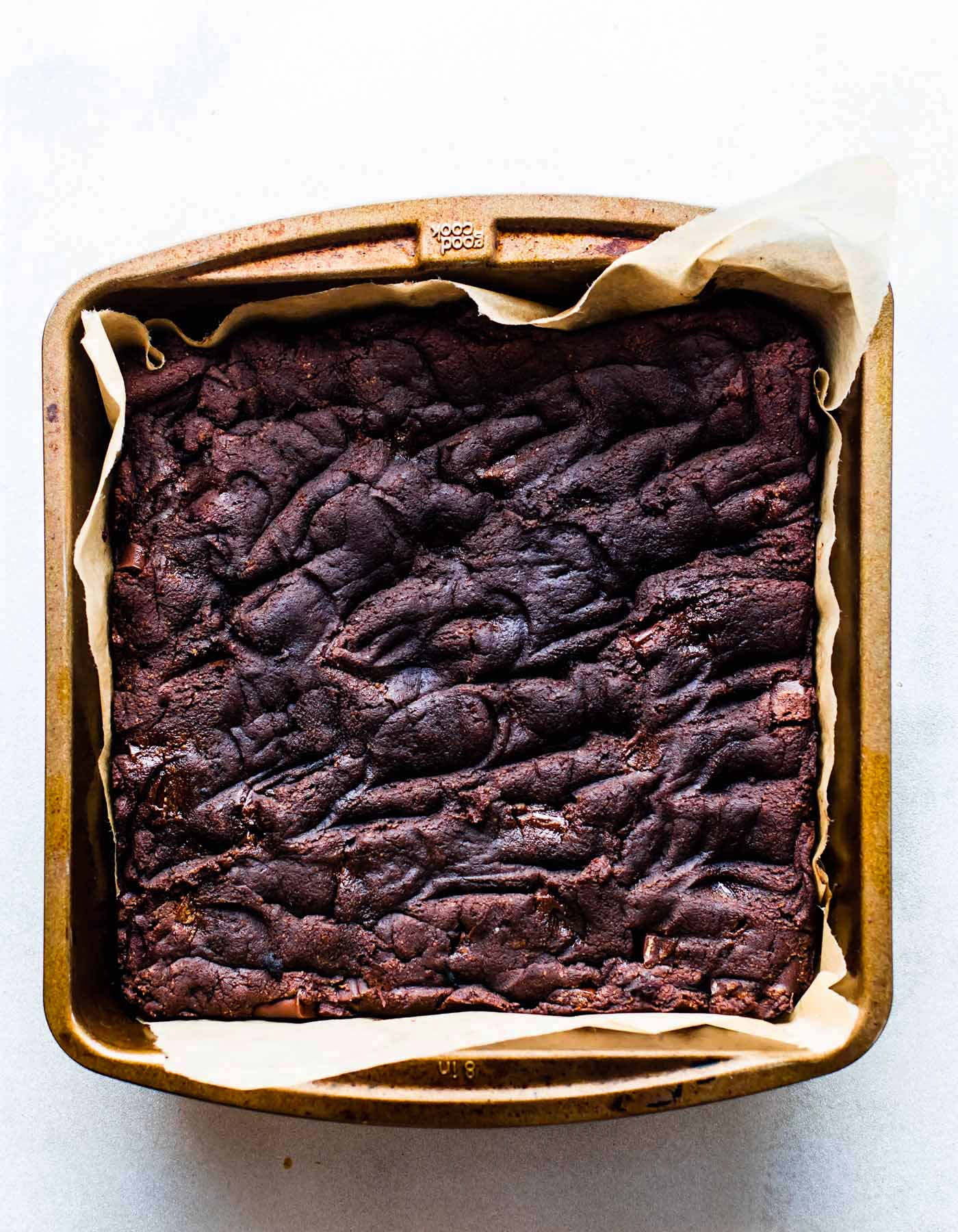 pan of paleo brownies with dark chocolate