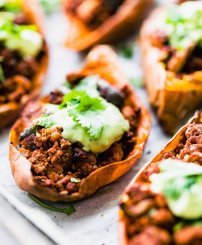 side shot photo: sweet potato skin appetizer, filled with lean beef chili