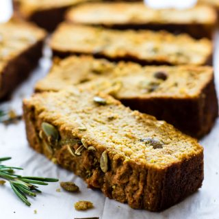 PALEO PUMPKIN BREAD with rosemary and pumpkin seeds! Rosemary Paleo Pumpkin Bread is an easy quick bread recipe! Get the healthy, savory bread recipe here!