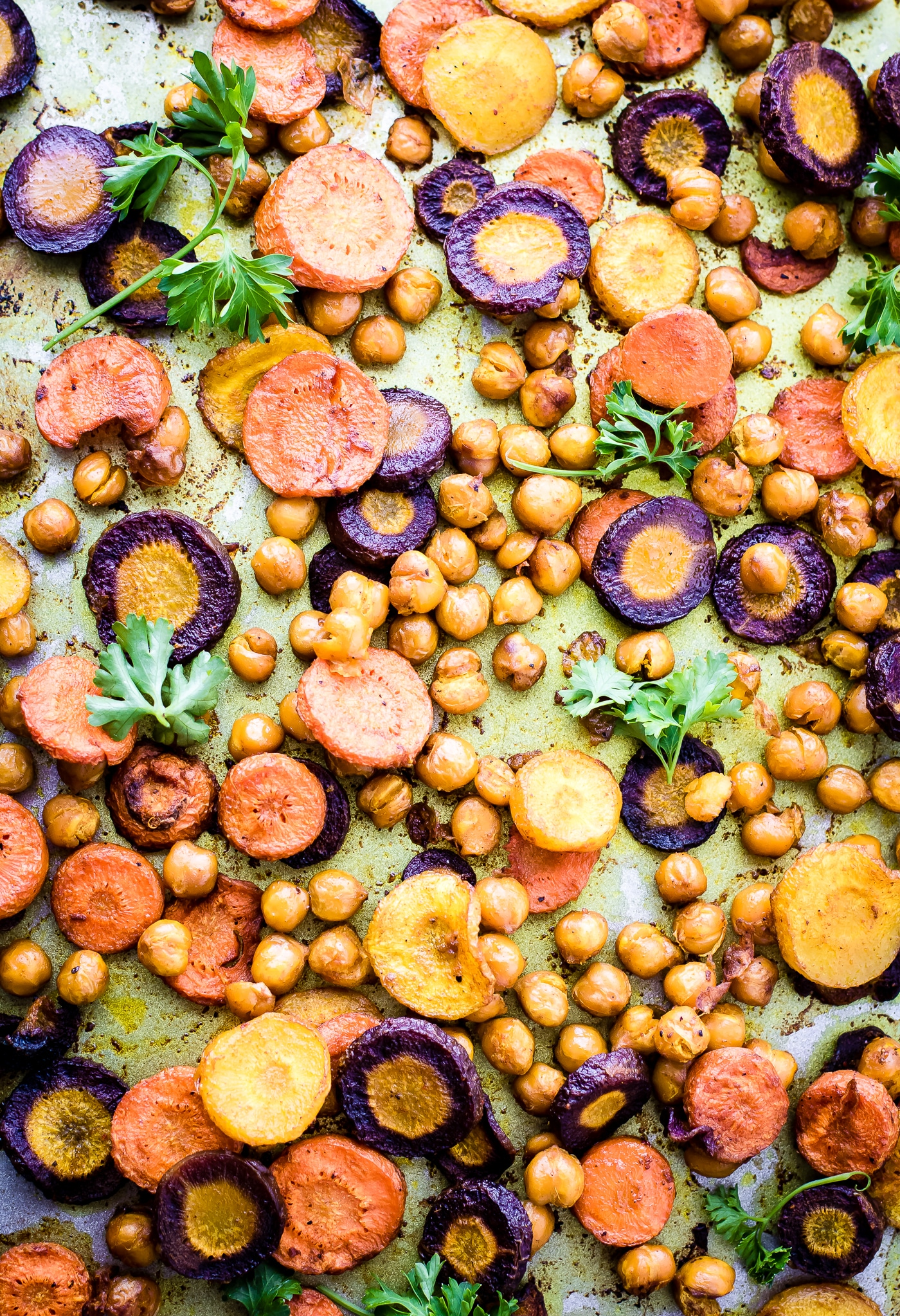 overhead image of rainbow carrots and chickpeas on a counter