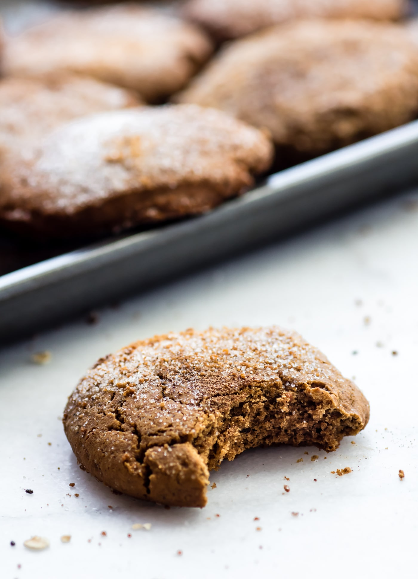 gluten free Brown Butter Snickerdoodle cookie with a bite taken out of it