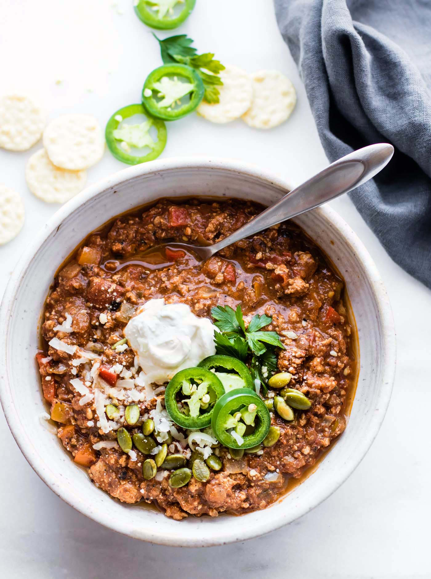 Turkey Chili with a Mexican flare! Quick Sweet Potato Mole Turkey Chili that's Paleo friendly, simple to make, and healthy! A hearty Turkey chili made with an easy homemade sweet potato mole sauce. Great to feed a crowd, for meal prep, or to use up those holiday leftovers.