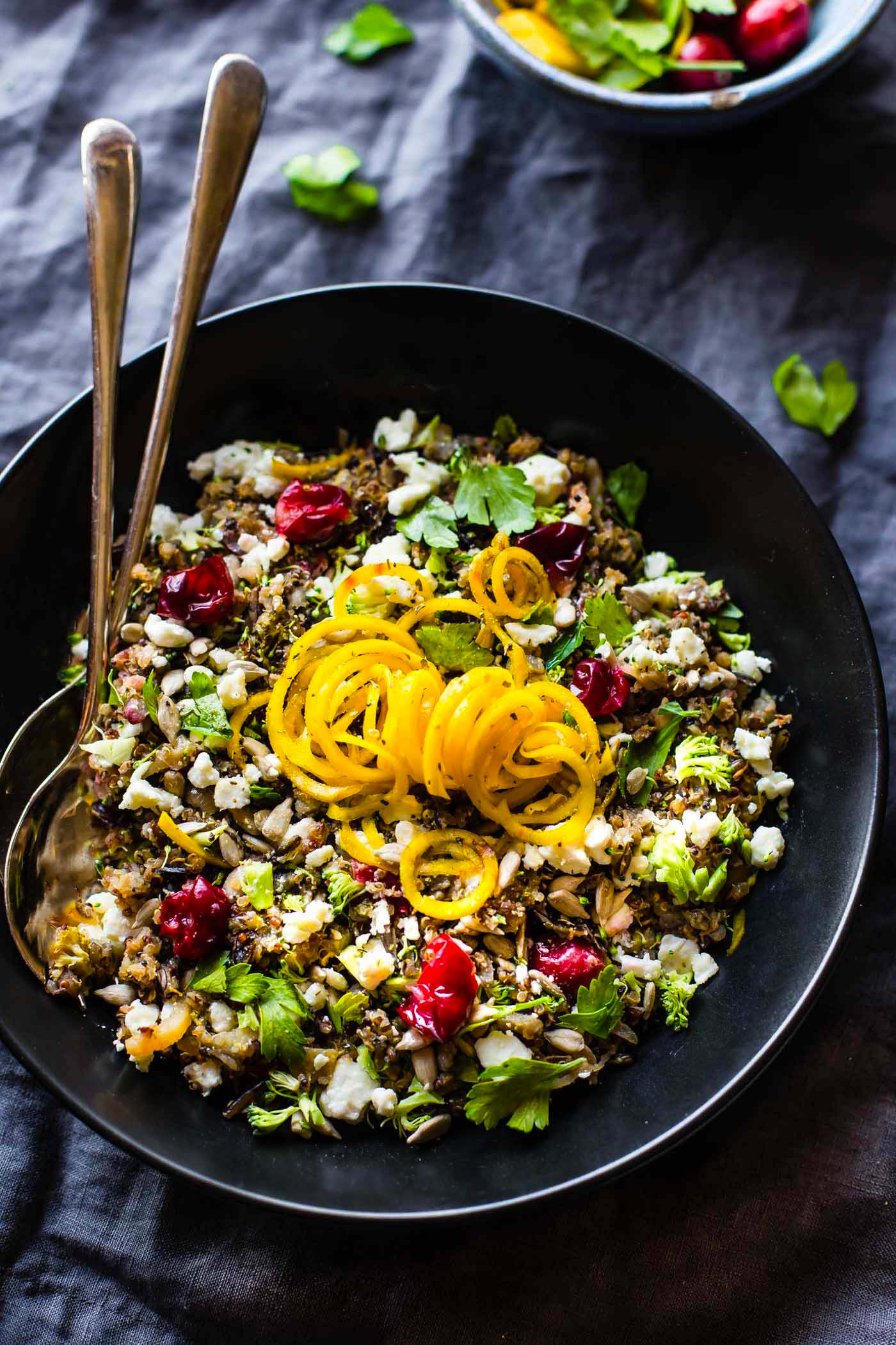 A bowl of healthy quinoa pilaf with beets, broccoli and cranberries