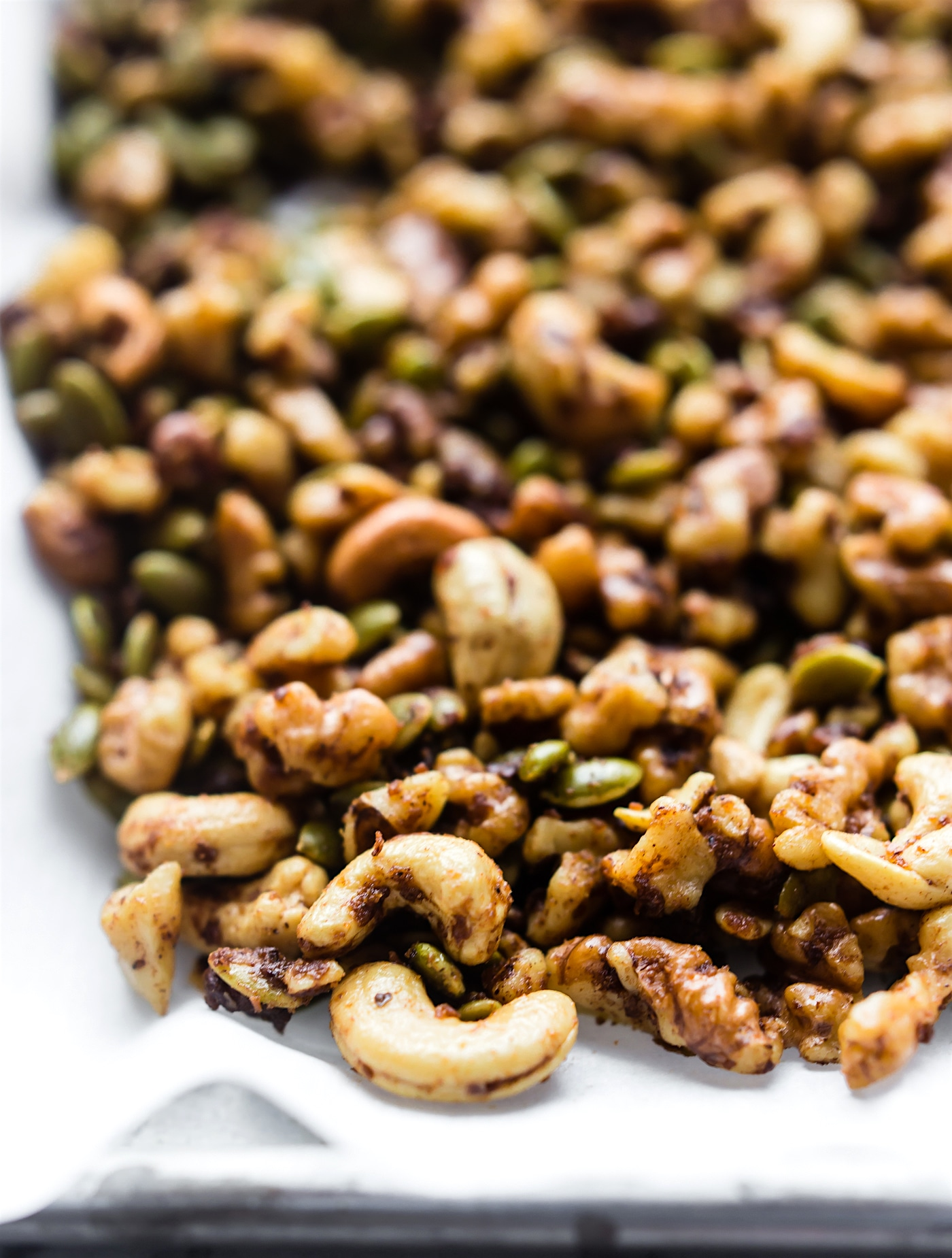 toasted nuts and seeds on a baking sheet