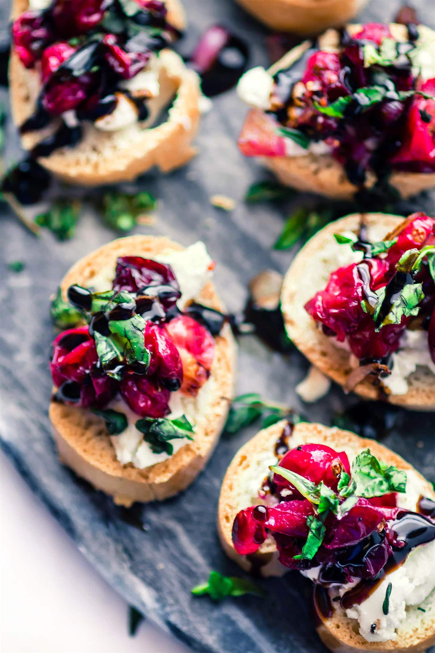 holiday appetizers - a platter of gluten free cranberry goat cheese crostini bites