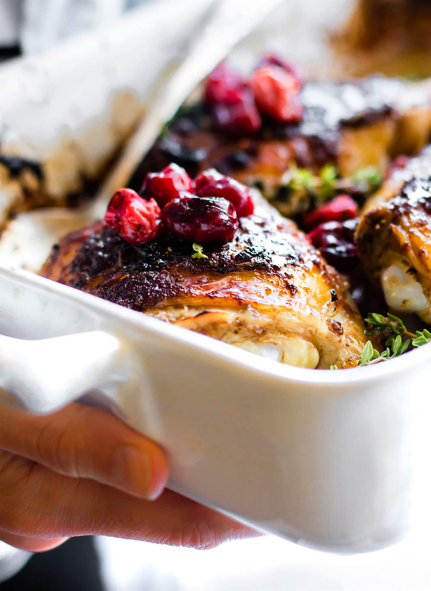 Balsamic Roasted Chicken with Cranberries prepped and cooked in ONE PAN! Yes, your holiday table is complete. This Paleo Cranberry Balsamic Roasted Chicken is a simple yet healthy dinner. A sweet tangy marinade makes this roasted chicken extra juicy and extra crispy. One of our go to meals for meal prep too.