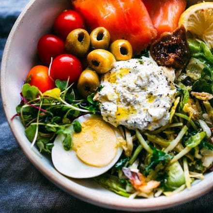 warm salad with smoked salmon, green olives, egg and whipped goat cheese