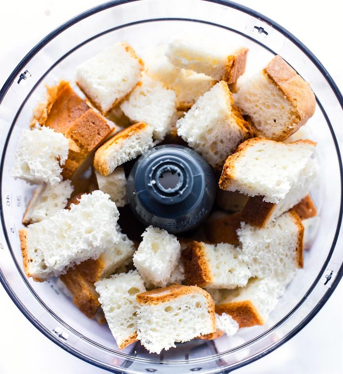 bread diced up in food processor- overhead shot