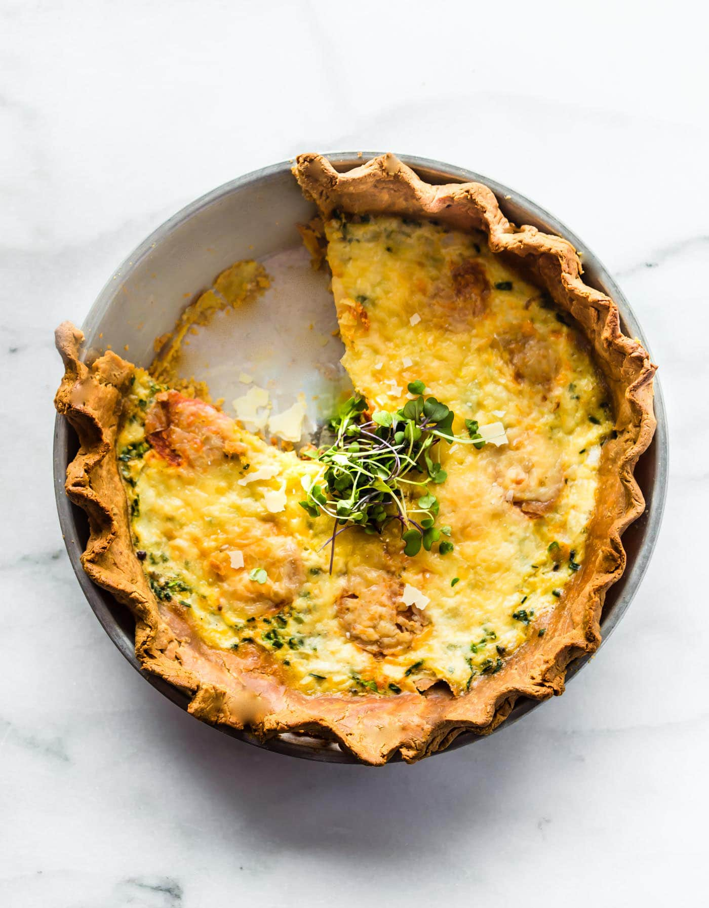 made from scratch quiche with a slice removed