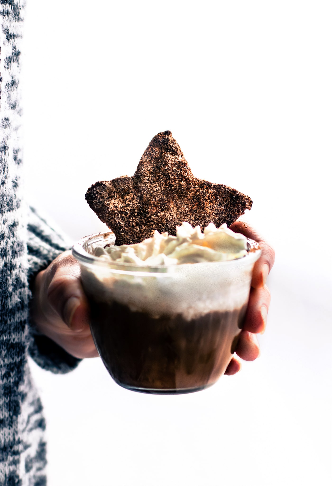 a mug of Mexican hot chocolate with a chocolate sugar cookie dipped into it