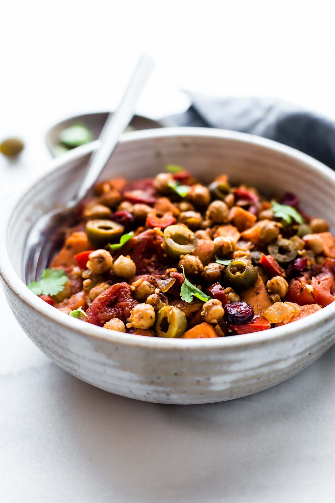 These Cuban Sweet Potato Picadillo Bowls make for a wholesome Latin-inspired weeknight meal! This vegan picadillo recipe is the perfect combo of sweet and savory. Stewed Tomatoes, roasted chickpeas, sweet potatoes, olives, raisins, and spices! Simple healthy ingredients made into a flavorful one pot meal. Gluten free, grain free, EASY!