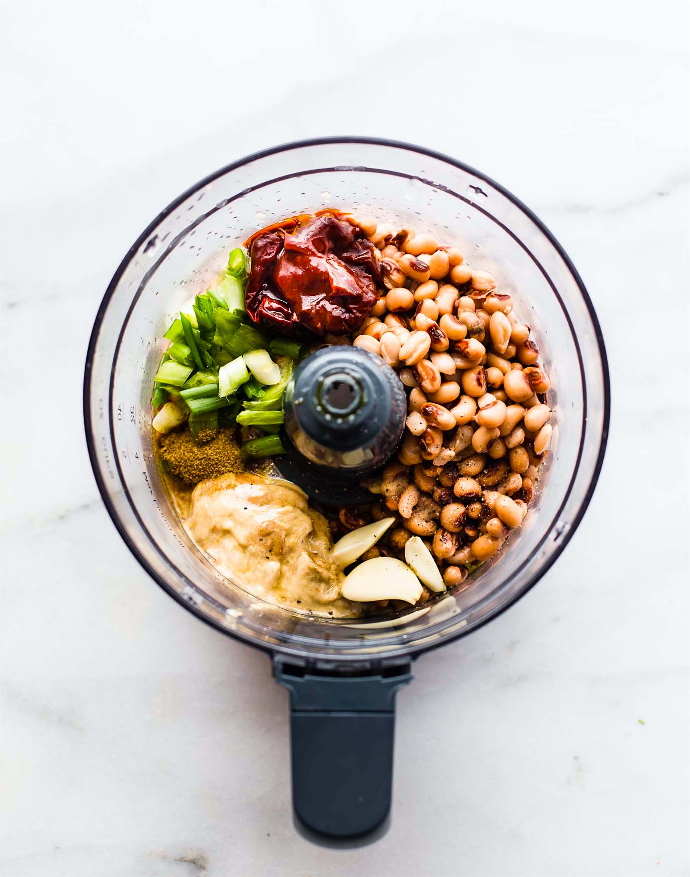 Vegan Chipotle Black Eyed Peas Hummus to start off the New Year. A fun Spicy twist on classic hummus with black-eyed-peas in place of garbanzo beans! This healthy hummus packs in some spice and flavor with the addition of chipotle peppers, onion, and garlic. Smokey, creamy, and gluten free! Perfect option for a quick snack or appetizer.