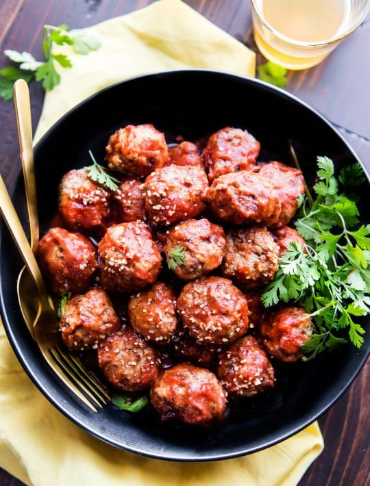 Paleo Meatballs with a sweet Sriracha sauce! These sweet and spicy Paleo meatballs are easy to make in under 45 minutes. Simple ingredients, super tasty, and protein packed! Great as an appetizer, meal, or meal prep addition. Freezer friendly ya'll!