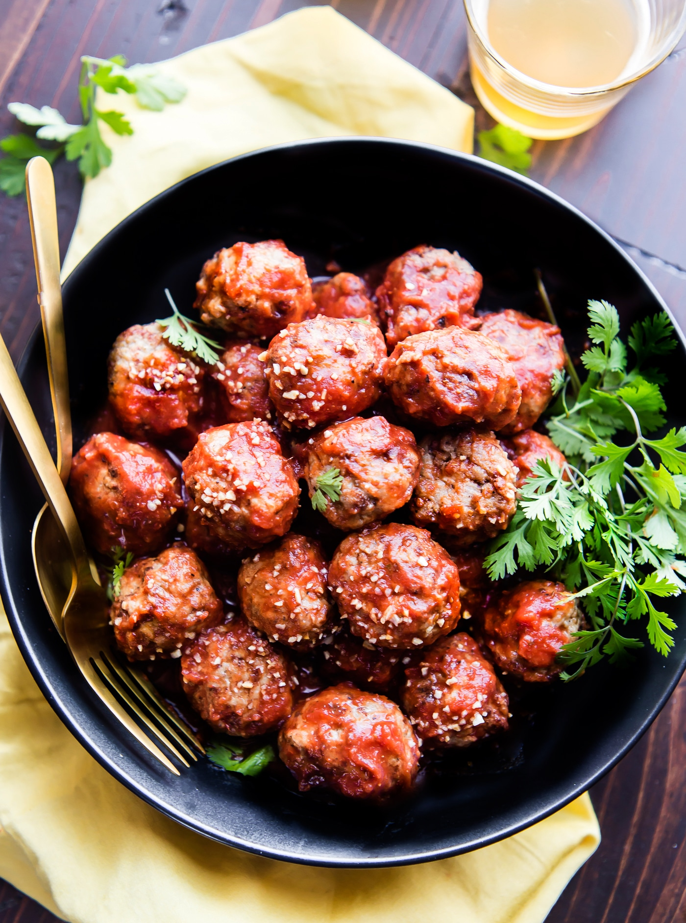 Paleo Meatballs with a sweet Sriracha sauce! These sweet and spicy Paleo meatballs are easy to make in under 45 minutes. Simple ingredients, super tasty, and protein packed! Great as an appetizer, meal, or meal prep addition. Freezer friendly, whole30 friendly!