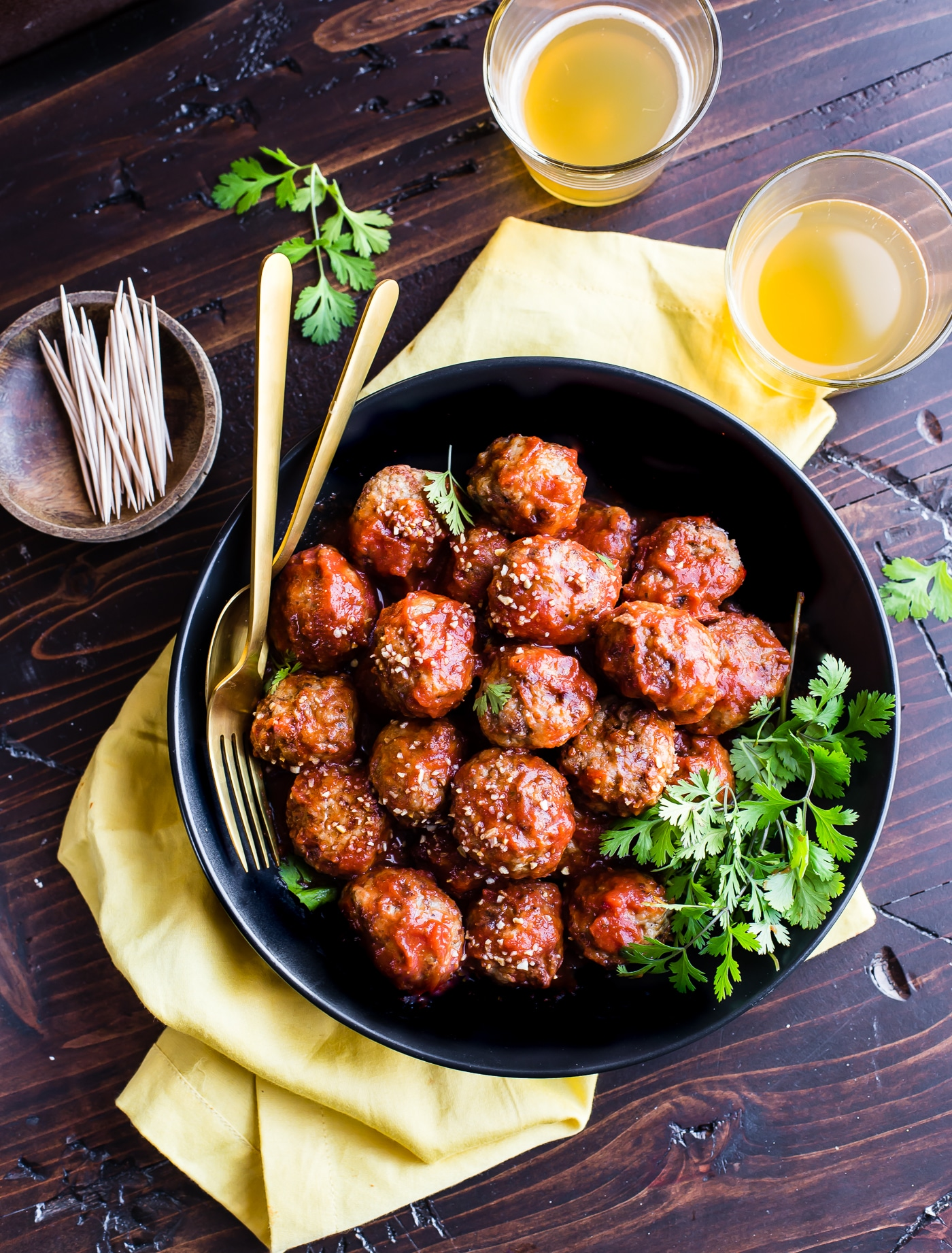 Paleo Meatballs with a sweet Sriracha sauce! These sweet and spicy Paleo meatballs are easy to make in under 45 minutes. Simple ingredients, super tasty, and protein packed! Great as an appetizer, meal, or meal prep addition. Freezer friendly, whole 30 friendly.