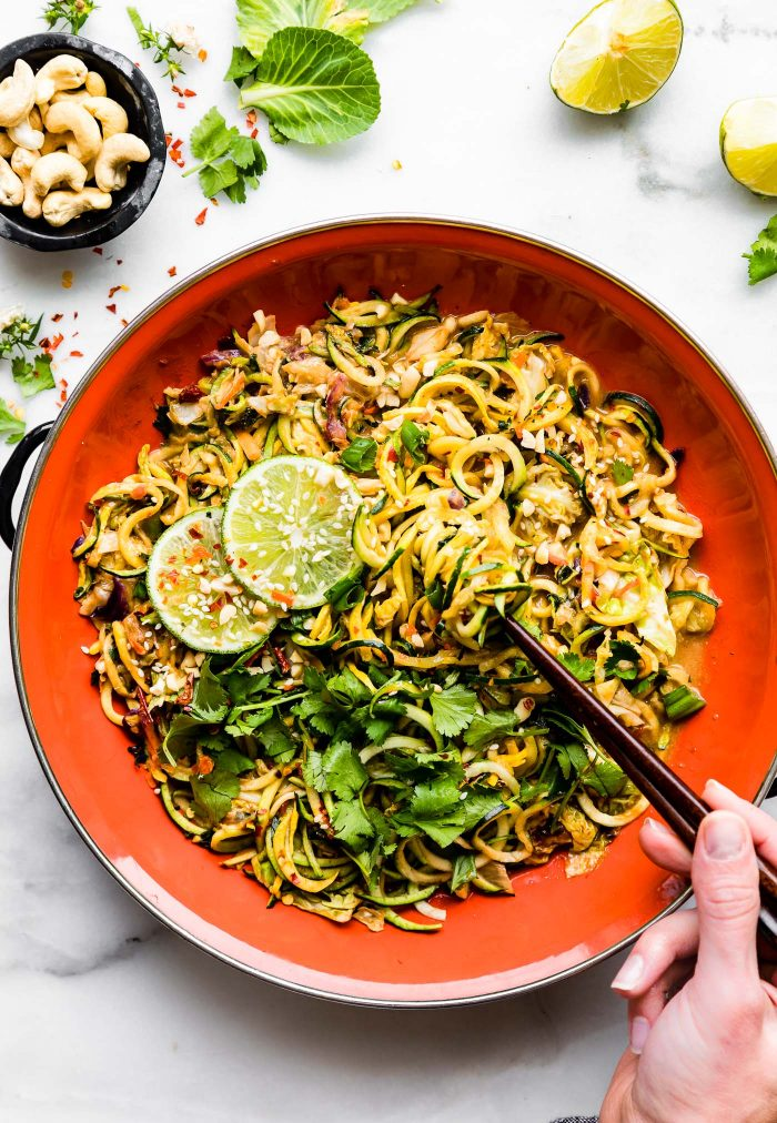 Spice things up with a spiralized vegetable stir fry recipe! This easy vegetable stir fry recipe is cooked in a cashew satay sauce and is simply delicious.  A one pan dinner that takes just 20 minutes to make. Paleo and vegan friendly. . #vegan #stirfry #satay #paleo #dinner