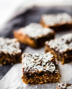 coconut almond butter jelly bars on a plate