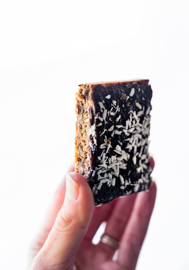 Paleo Almond Butter Jelly Energy Bars are one of our favorite bars that fuel us for workouts and snacking on the go. One of my favorite easy meal prep recipes!