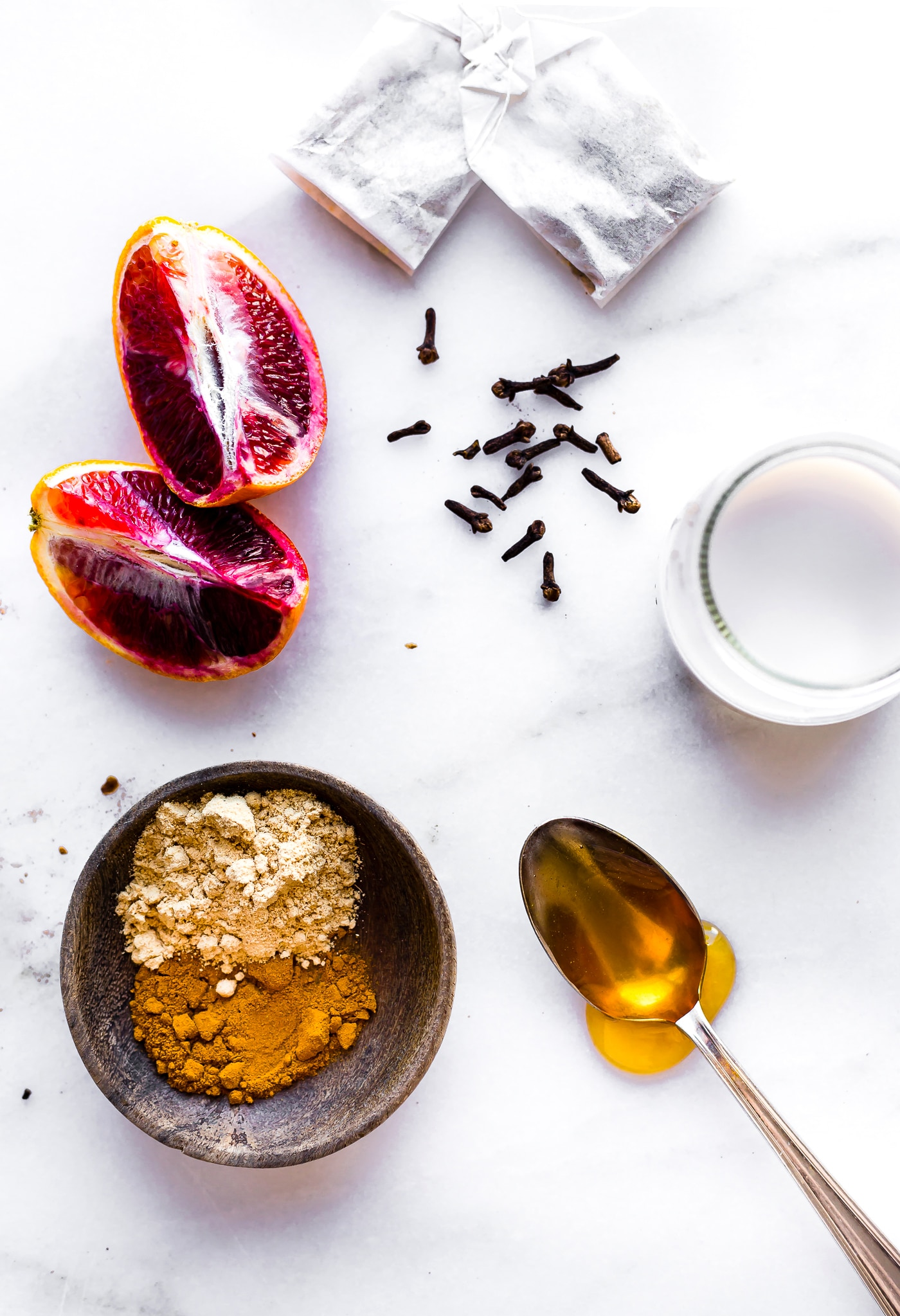 ingredients to make a blood orange turmeric tea latte