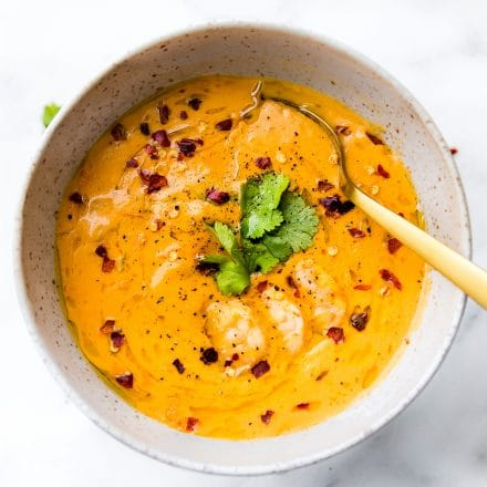 This creamy roasted red pepper bisque with Shrimp is dairy free, paleo, and totally delicious! A spicy bisque with healing immunity boosting nutrients. Perfect for cold weather or under the weather! Also a great way to get veggies into your meal. Nourish your family, feed your friends, or enjoy this robust roasted red pepper bisque recipe all to yourself. Whole 30 compliant! | CotterCrunch.com