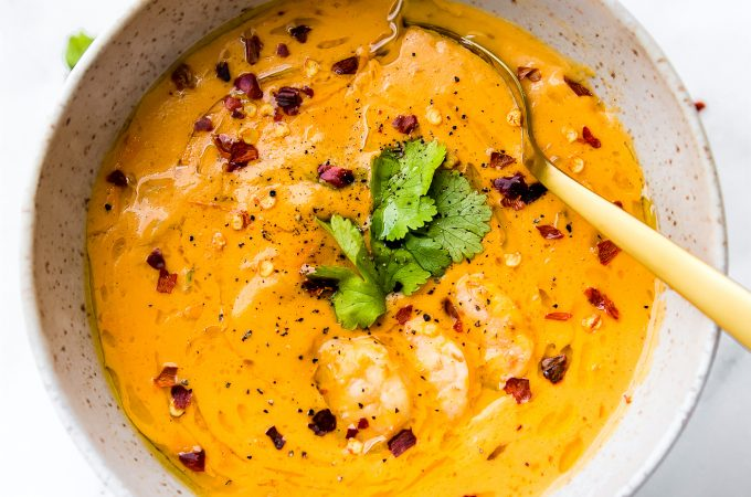 This creamyroasted red pepper bisquewith Shrimp is dairy free, paleo, and totally delicious! A spicybisque with healing immunity boosting nutrients. Perfect for cold weather or under the weather! Also a great way to get veggies into your meal. Nourish your family, feed your friends, or enjoy thisrobust roasted red pepper bisque recipe all to yourself. Whole 30 compliant! | CotterCrunch.com