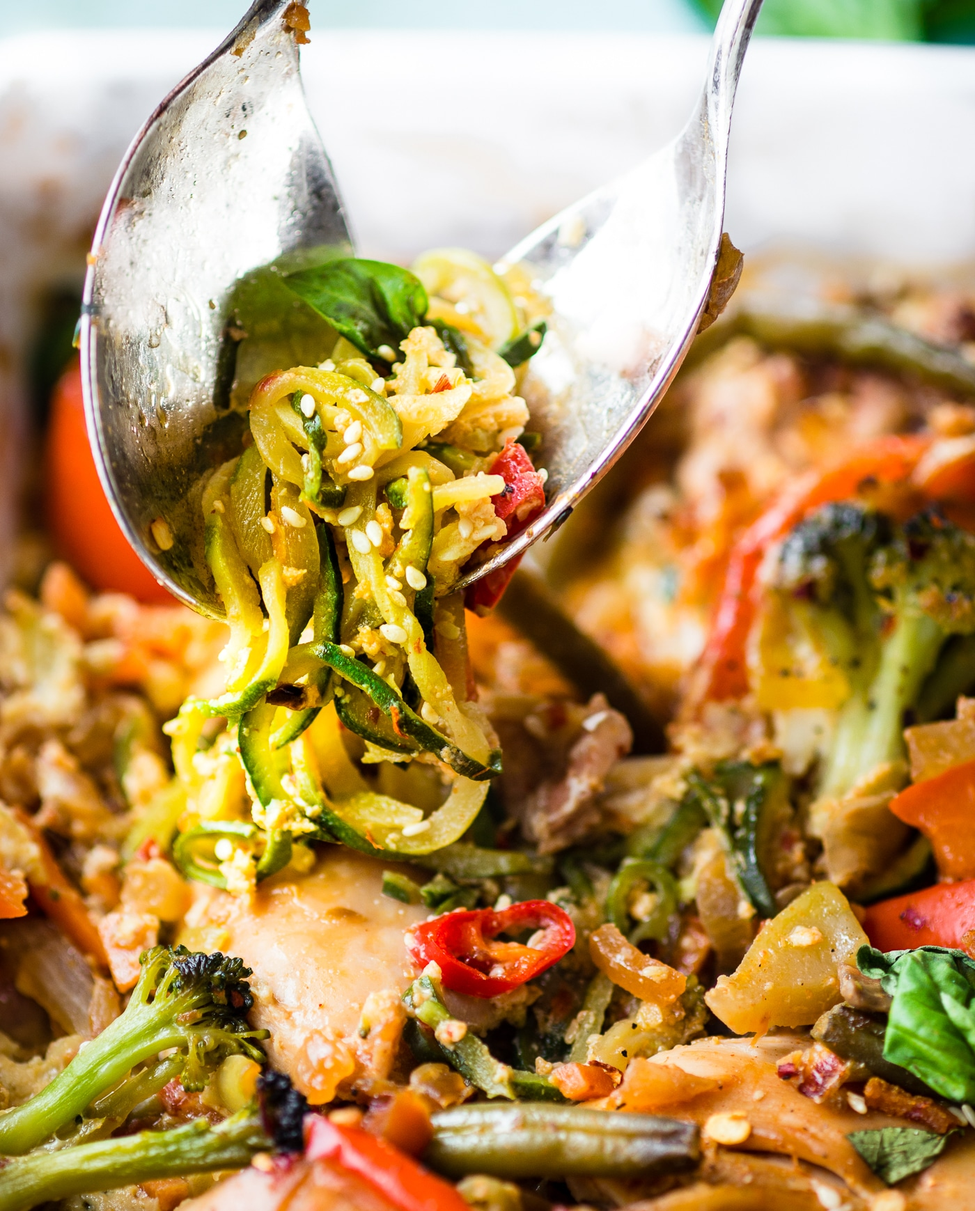 Drunken Chicken Zoodle Casserole takes a spin on the original Pad kee mao Asian stir fry and puts it in casserole form. A paleo zucchini noodle casserole with tons of flavor, Thai spices, and simple healthy ingredients! A delicious, light, high protein, low carb recipe. | CotterCrunch.com