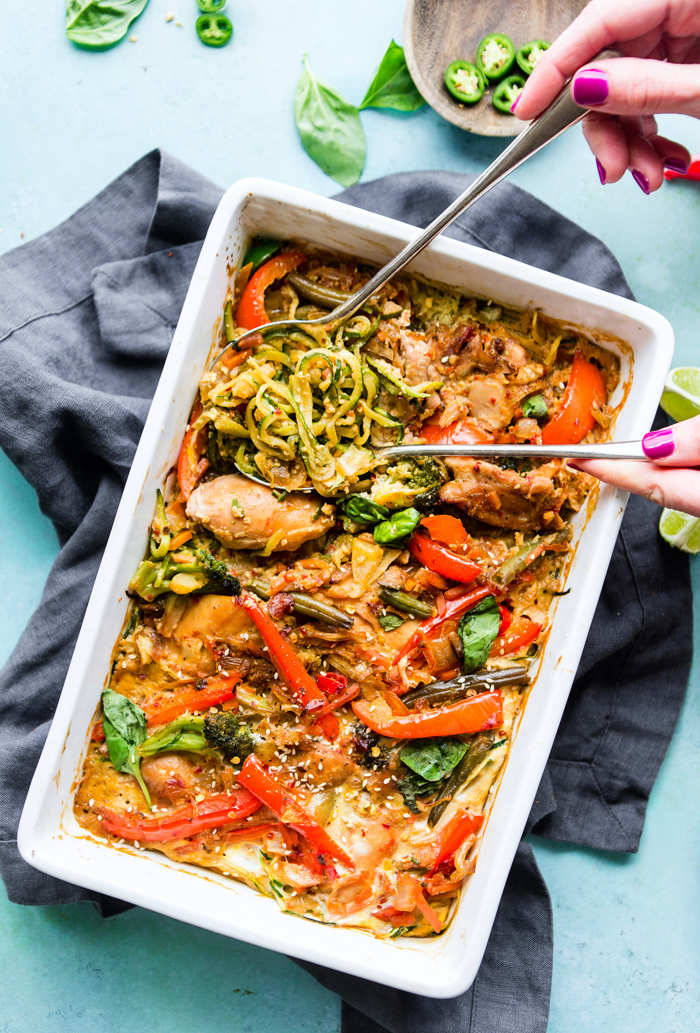 Drunken Chicken Zoodle Casserole takes a spin on the original Pad kee mao Asian stir fry and puts it in casserole form. A paleo zucchini noodle casserole with tons of flavor, Thai spices, and simple healthy ingredients! A delicious, light, high protein, low carb recipe. dairy free and gluten-free anti-inflammatory meal plan