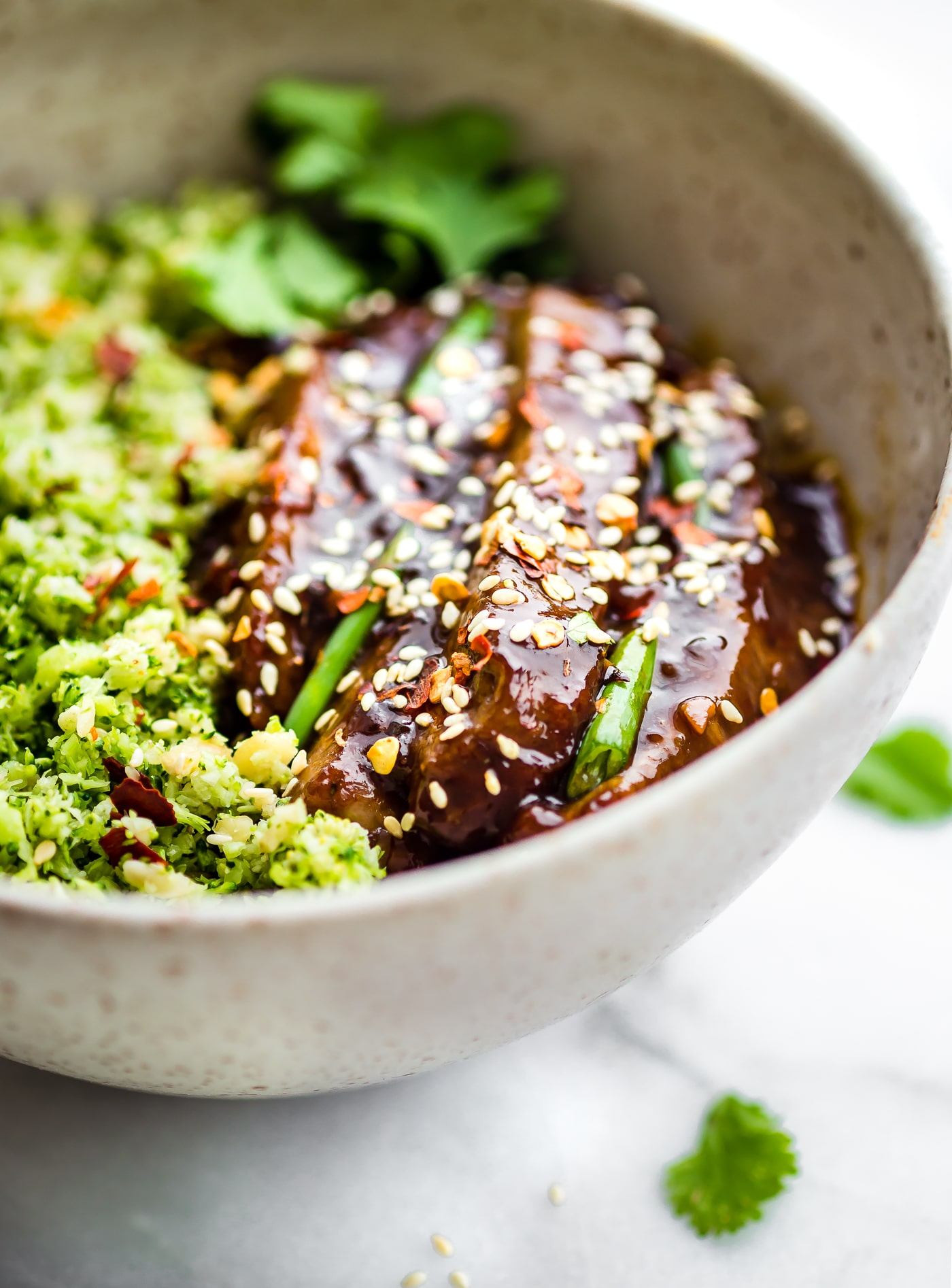 "These Paleo Mongolian Beef Broccoli ""Rice"" Bowls are quick to make, light, and full of garlic and ginger flavors! A Healthy Asian homemade takeout recipe!"
