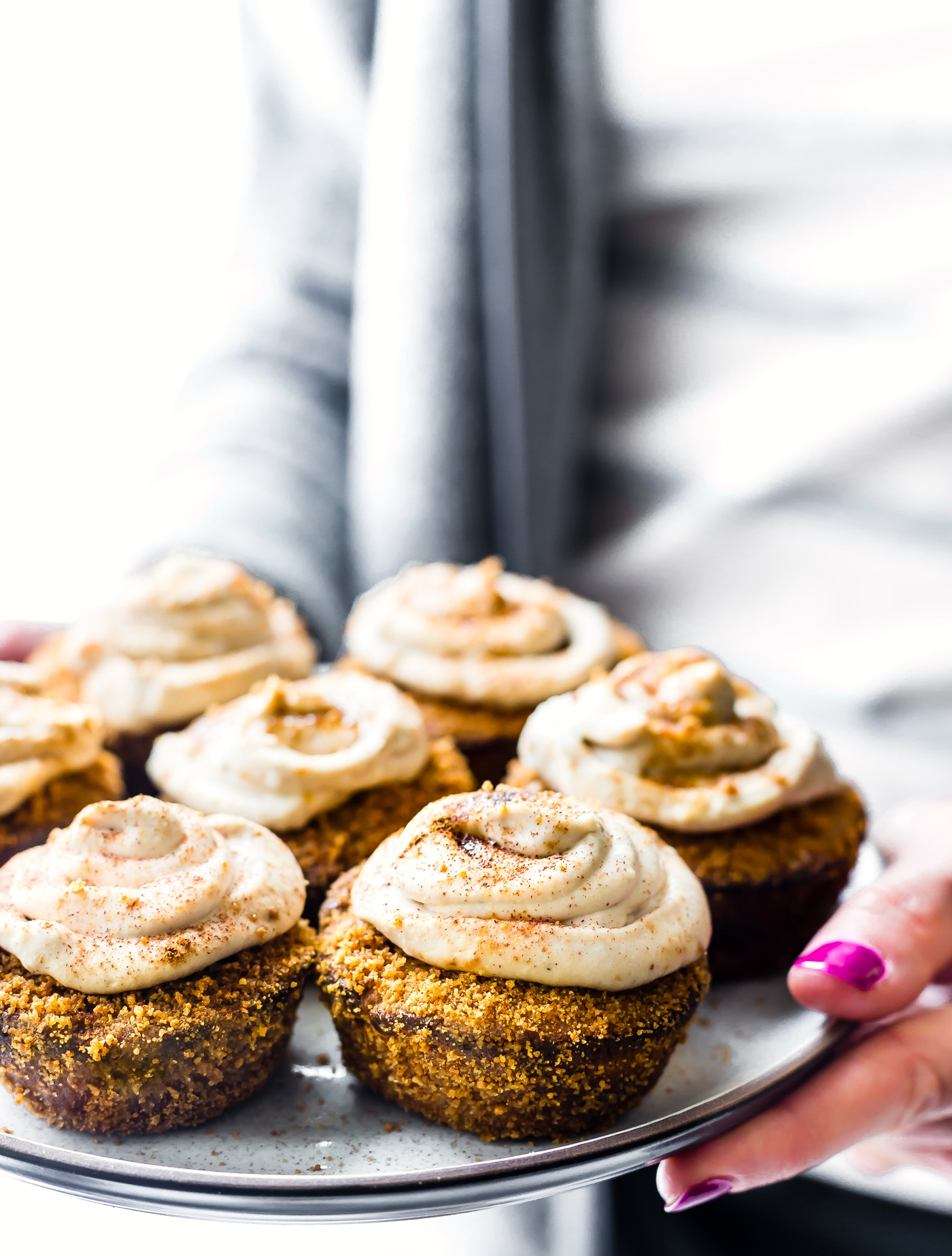 These Flourless Peanut Butter Churro Cupcakes with Coconut Frosting just might make your day! A flourless cupcake that's easy to make, oh so sweet and buttery, and even has a paleo option. Cinnamon Sugar and peanut butter fans will be happy. Our taste buds will be happy. Baking delicious gluten free cupcakes in less than 30 minutes will make everyone happy!