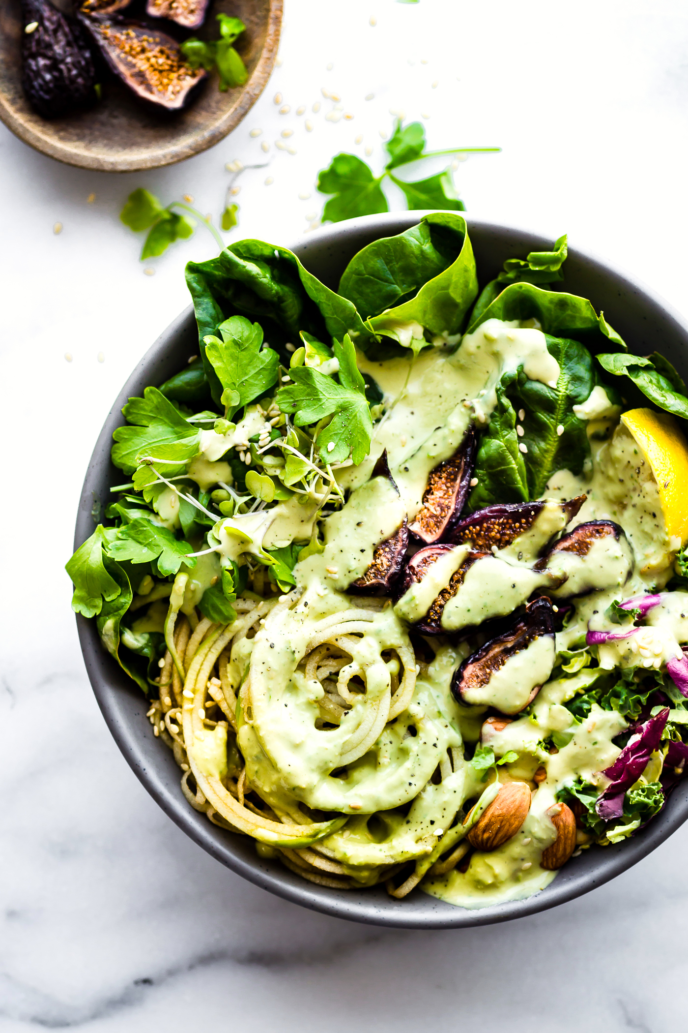 healthy salad topped with green goddess salad dressing