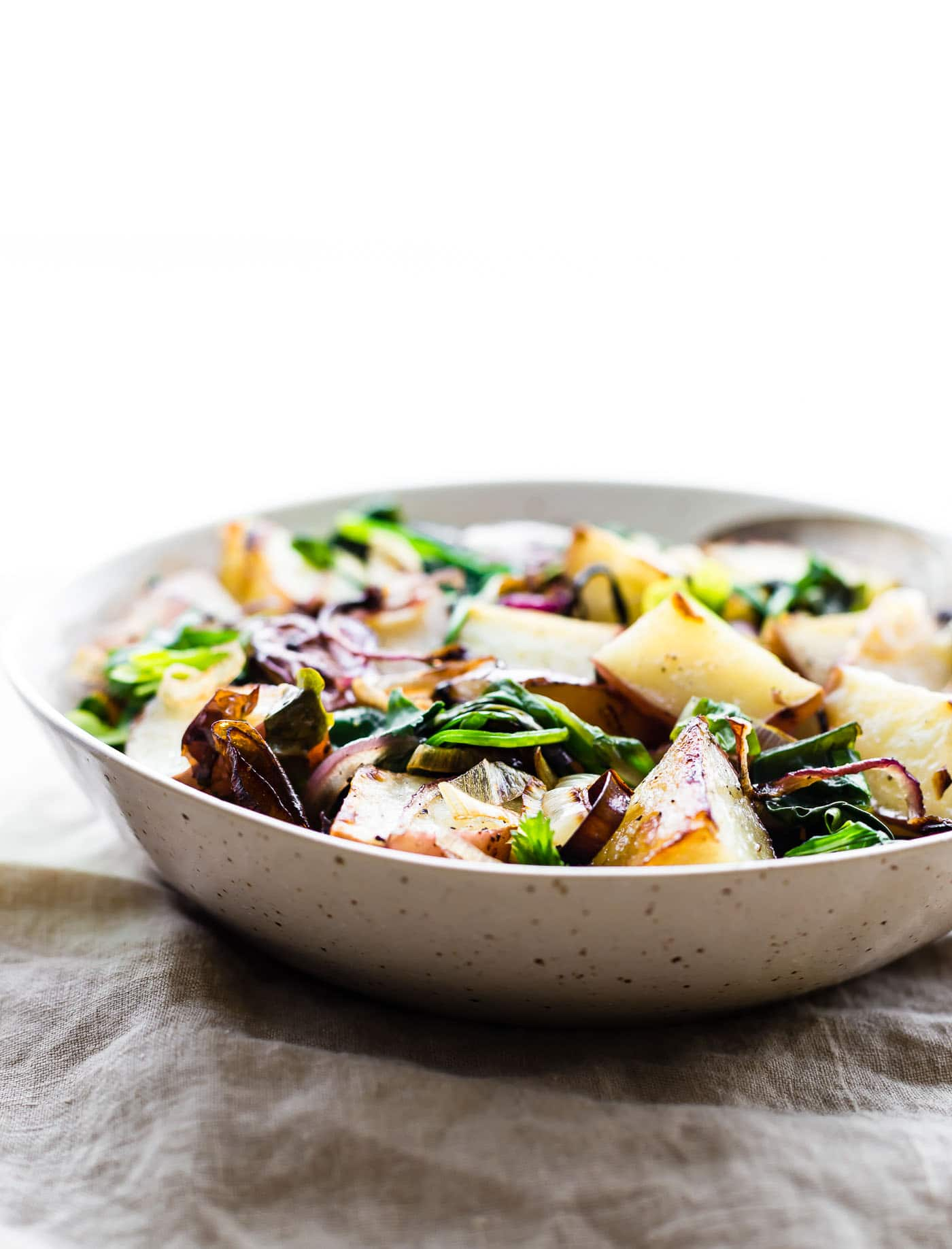 Spring Leek and Potato Pan roast! This Vegetable Pan Roast is packed with Seasonal Leek, Potato, and Steamed Spinach Greens! A flavorful, healthy, and easy to make side dish you can make all in one pan! A paleo/vegan Spring recipe perfect for any gathering. Whole 30 friendly!
