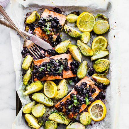 One pan Paleo SUPERFOOD Baked Salmon! This baked salmon recipe is ready in 20 minutes and packed full of nutrients. A nourishing, whole 30 friendly, flavorful meal! And all it takes is just a few simple real food ingredients. Promise! Get your sheet pan ready and grab a fork!