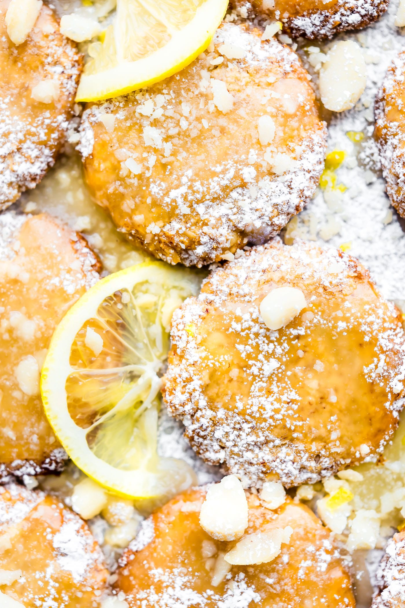 These Zesty Lemon Macadamia Nut Cookies have a wonderful flavor combination of coconut, lemon, and buttery macadamia nut! Chewy in the middle. Crispy outside and topped with a simple lemon glaze! So good and easy to make! Paleo and Vegan Friendly.