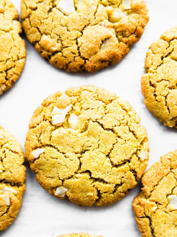 close up image of glazed macadamia cookies on white background