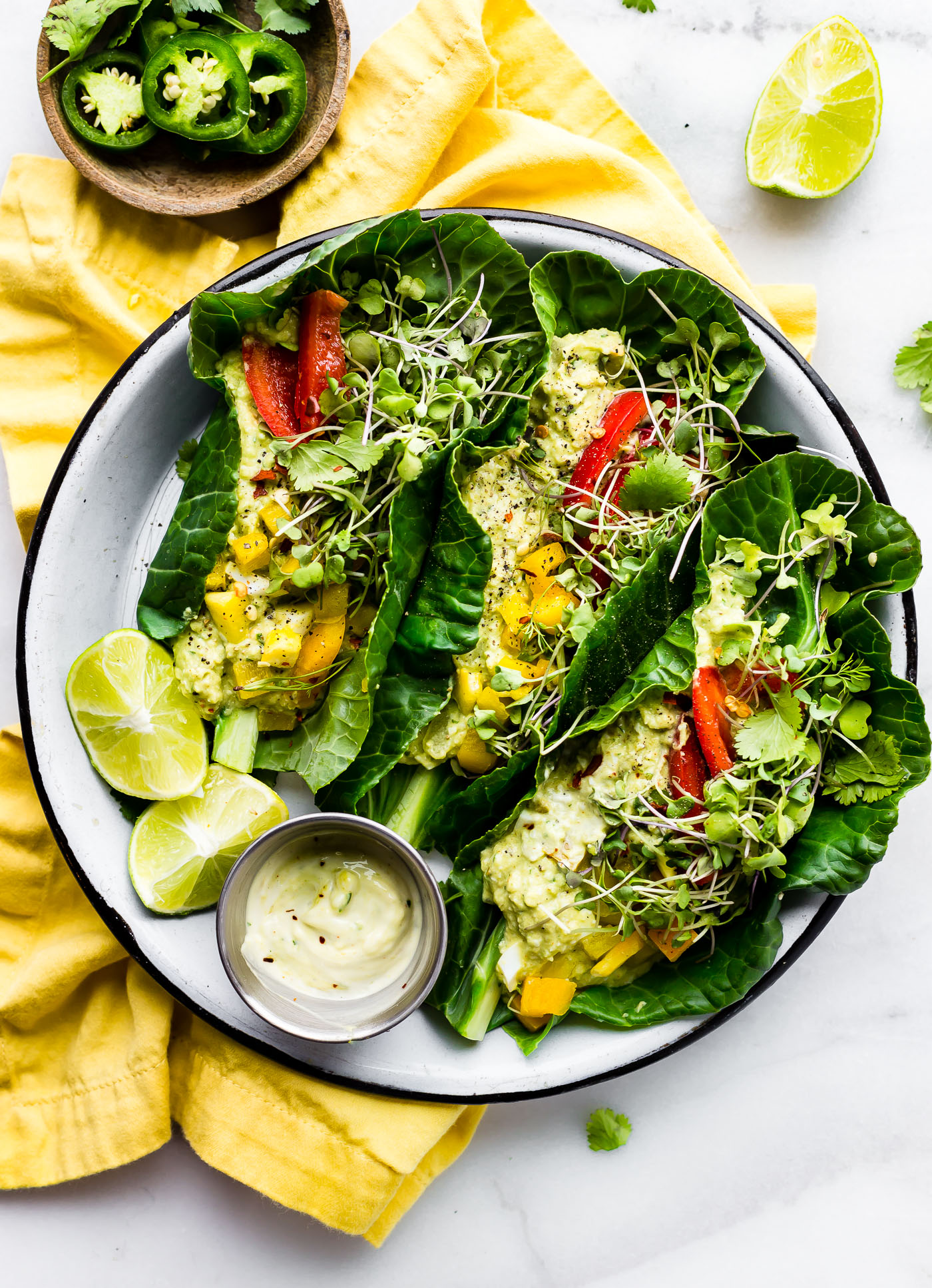 These Mexican avocado egg salad wraps make for a perfect low carb veggie packed lunch! Paleo Avocado Egg Salad seasoned with Mexican spices and jalapeño, then all wrapped up in collard greens! Whole 30 friendly.