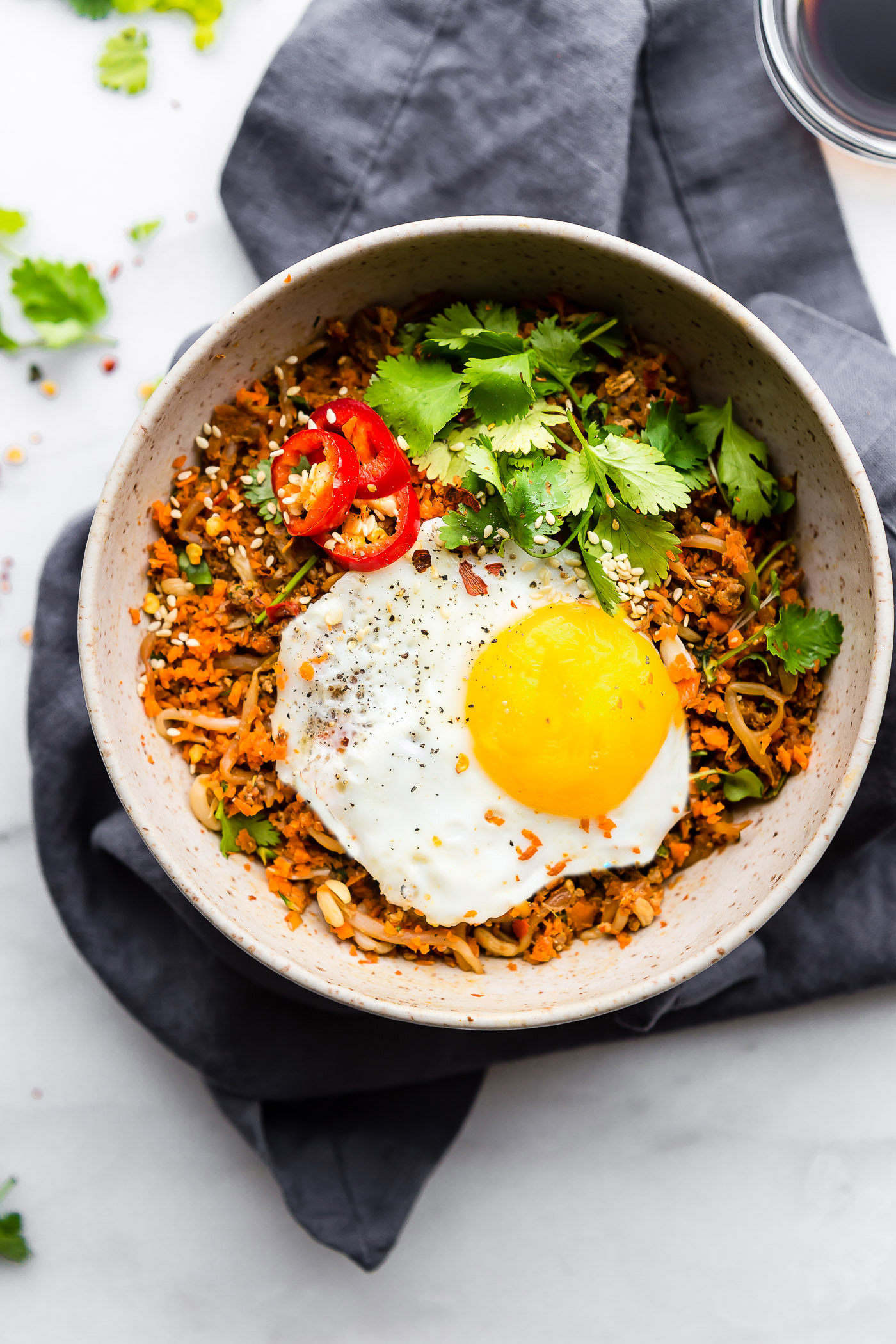 spicy Nasi Goreng breakfast with fried eggs and sausage