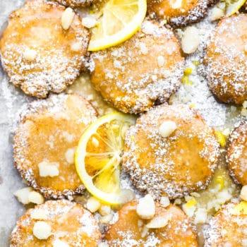 macadamia nut cookies with lemon glaze on baking sheet