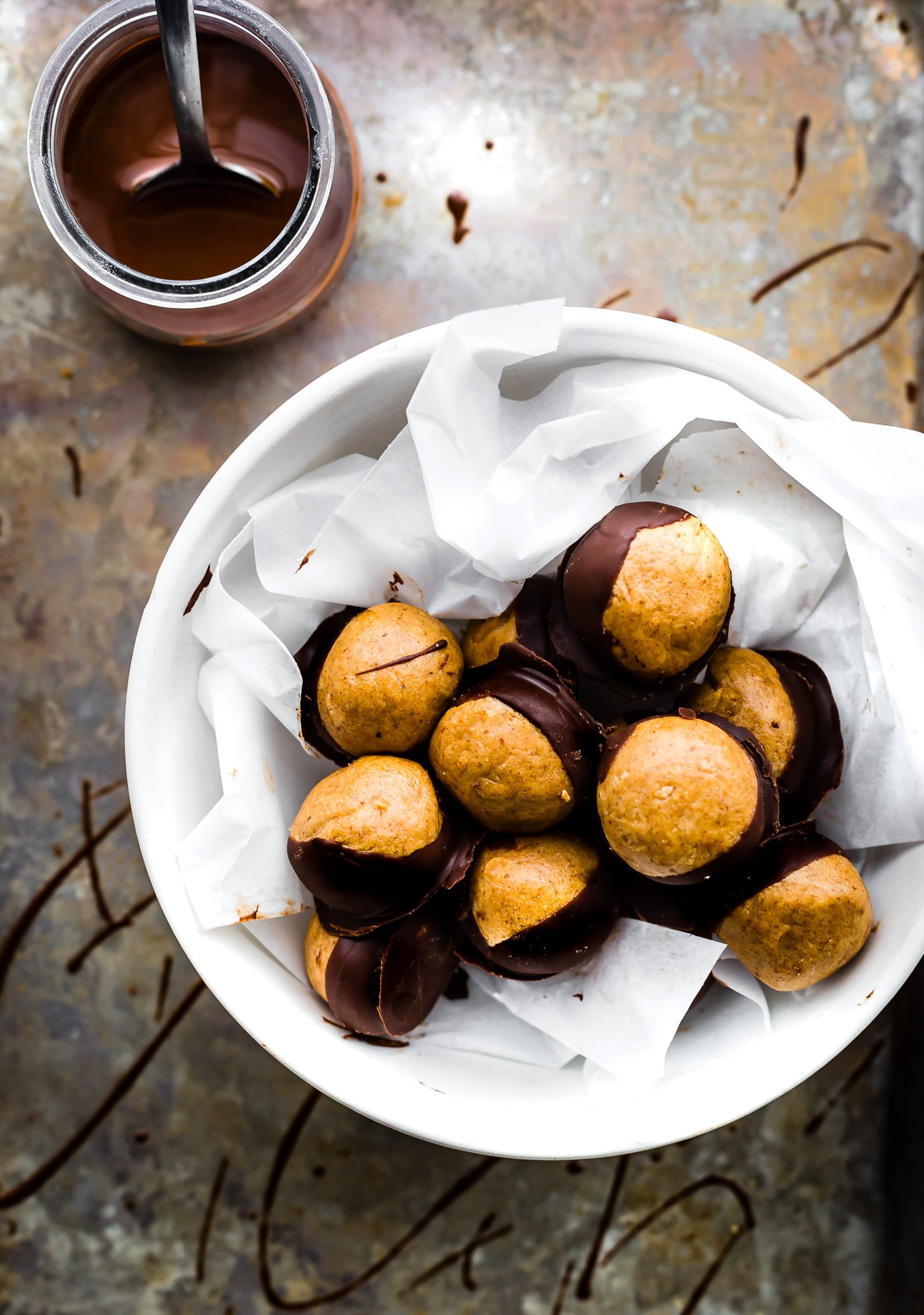 A Buckeyes Recipe Packed with Protein! These Vegan Peanut Butter Protein Buckeyes are super easy to make and coated in dairy free dark chocolate. Gluten free with a Paleo option. A classic Buckeyes Recipe with a healthy boost! No baking required so make as many as you can, mmm k?