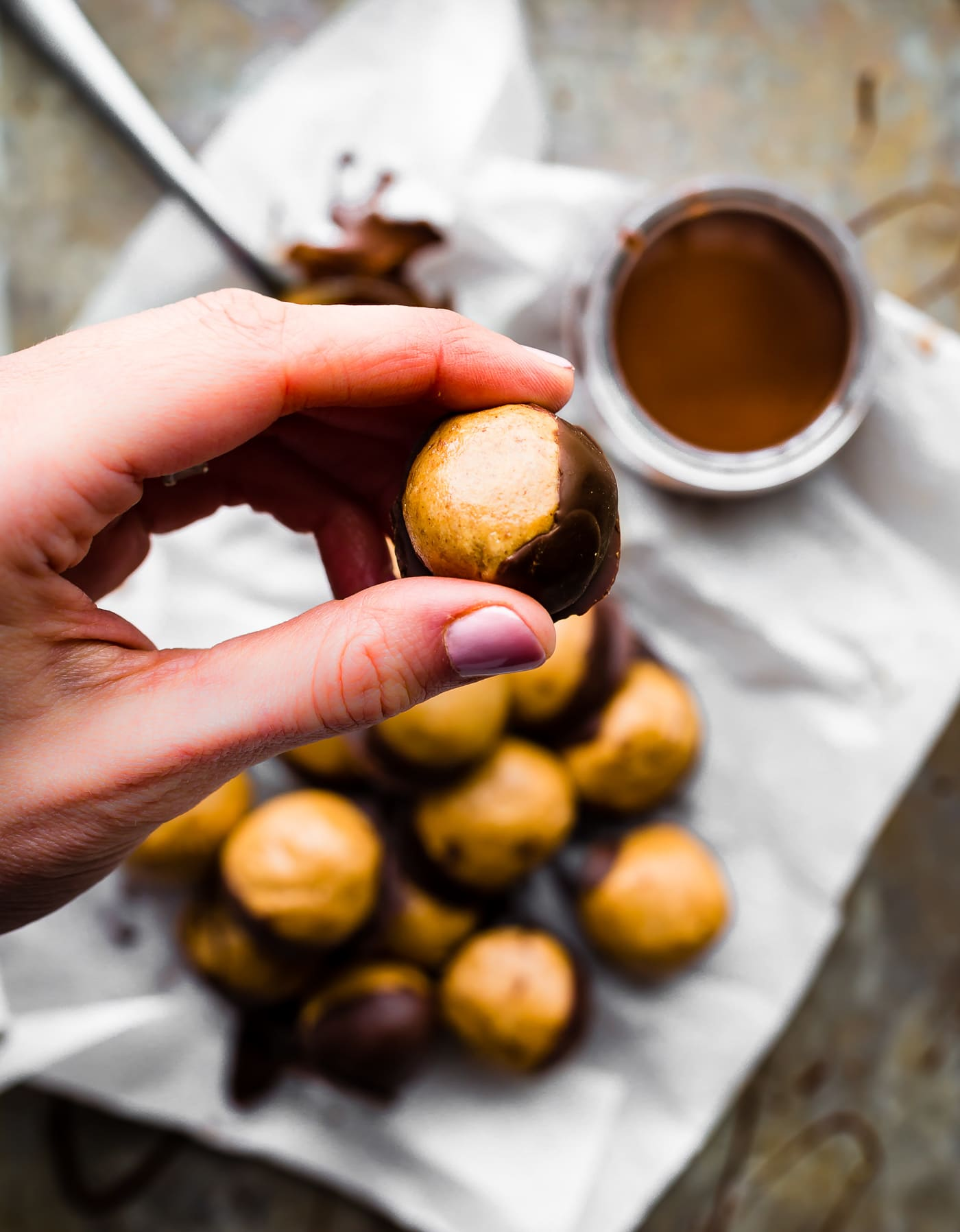 A Buckeyes Recipe Packed with Protein! These Vegan Peanut Butter Protein Buckeyes are super easy to make and coated in dairy free dark chocolate. Gluten free with a Paleo option. A classic Buckeyes Recipe with a healthy boost! No baking required! www.cottercrunch.com