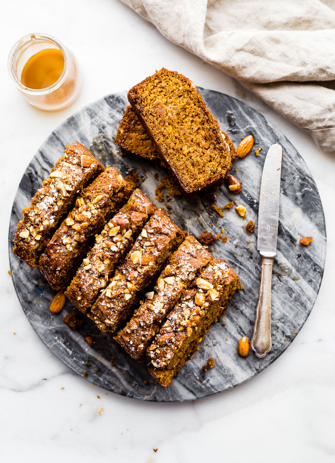 This Vegan Maple Almond Earl Grey Tea cake is lightly sweet and simple. A gluten free buttery tea cake loaf infused with Earl Grey tea and a hint cardamon! The maple almond glaze is the perfect topping. Quick to make in one pan and bakes up in under 45 minutes!