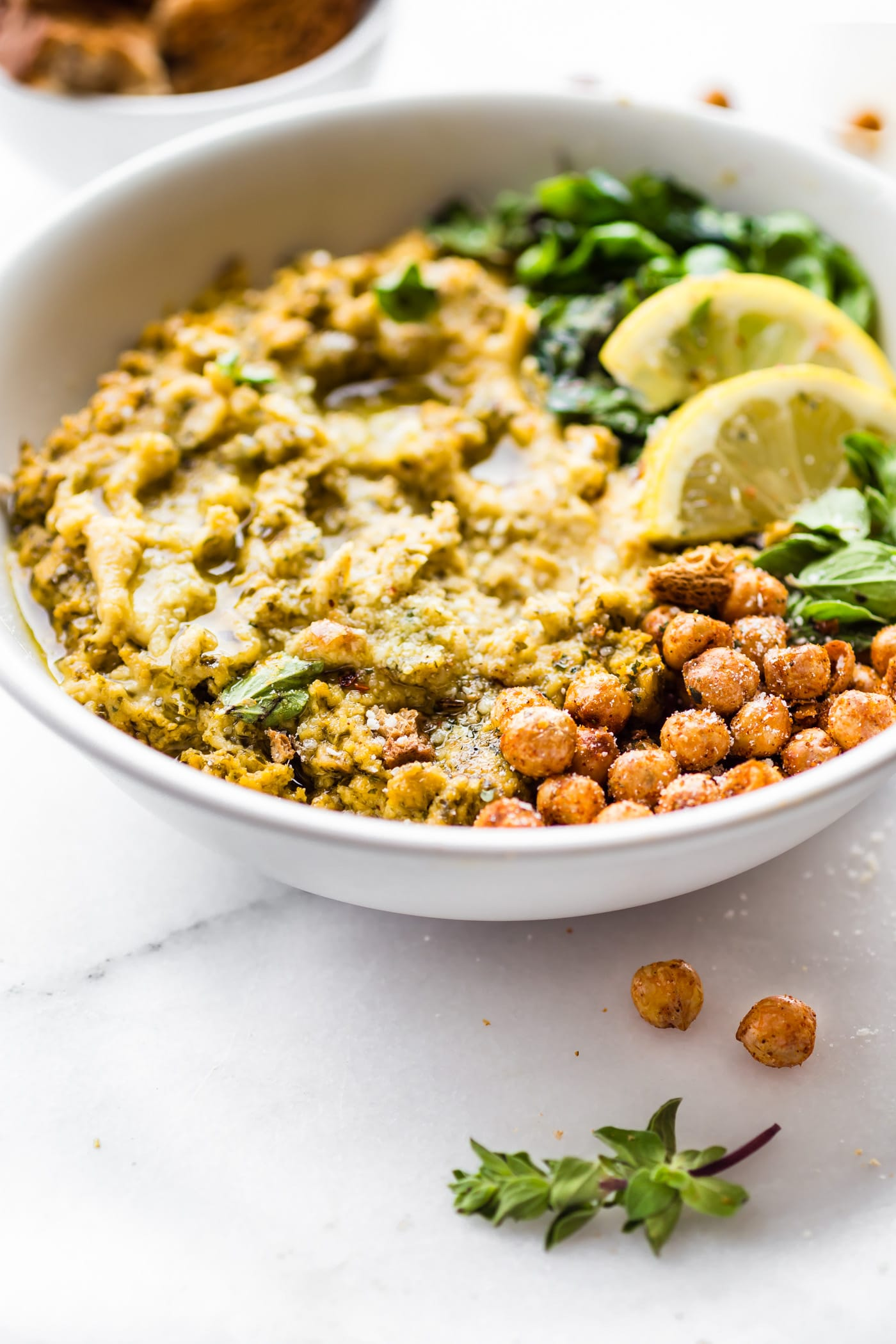 This Warm Mediterranean Spinach Artichoke Hummus Dip is a meal in itself. A vegetarian Mediterranean Baked Hummus Dip that's wholesome and healthy. Simple real food ingredients that you blend and bake! Gluten free, plant based, and delicious